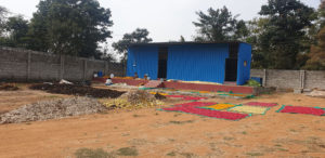 Discarded temple flowers being dried for making soaps