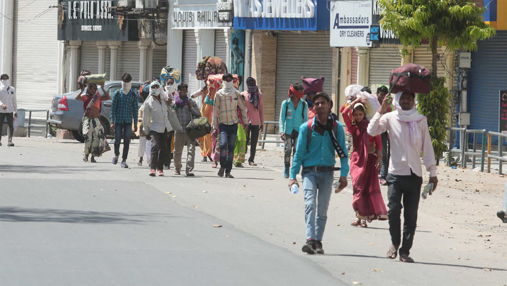 Migrant workers going home on foot amid Lockdown, Labour Day