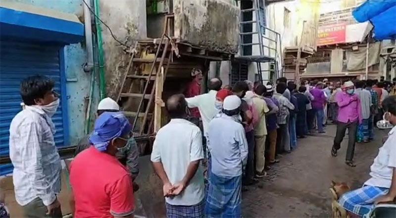 People queue up to get food in Dharavi amid COVID-19 lockdown