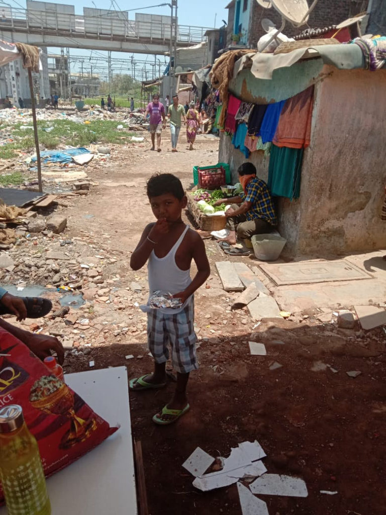 A child in a slum in Mahim East, Mumbai, after collecting food from a volunteer