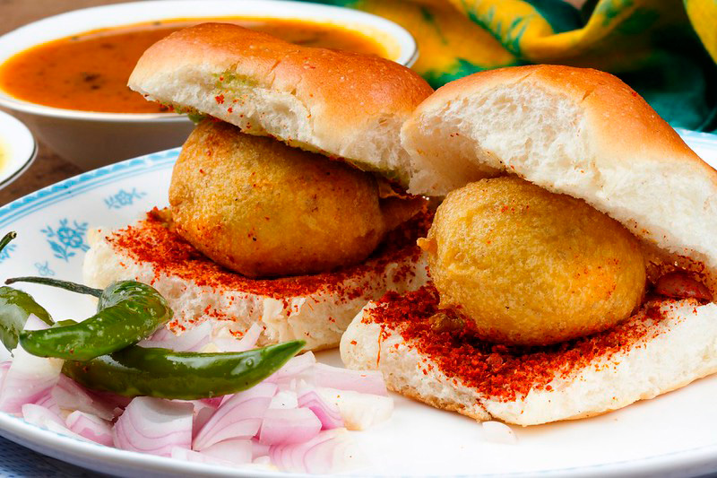 Vada Pav is another famous and much-loved snack --  potato patty is served in a bun with garlic, tamarind and green chutneys.  30 stades