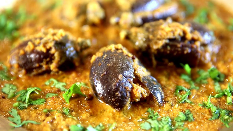 Bharli Vangi from the Konkan region are small eggplants stuffed with  peanuts, coconut, jaggery, goda masala, tamarind paste and other spices