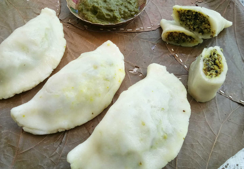 Dal pitha are steamed rice dumplings filled with dal.
