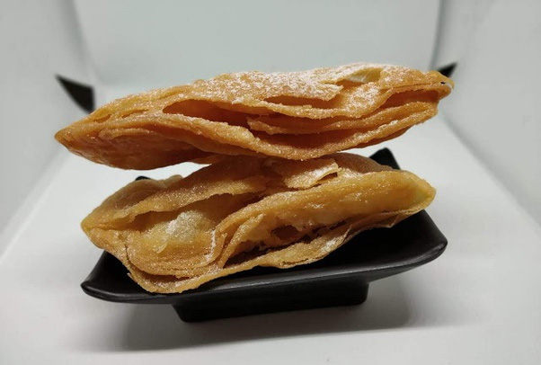 Khaja -- thin layered fritters soaked in sugar syrup.  Khaja from Silao in Nalanda is the most famous.