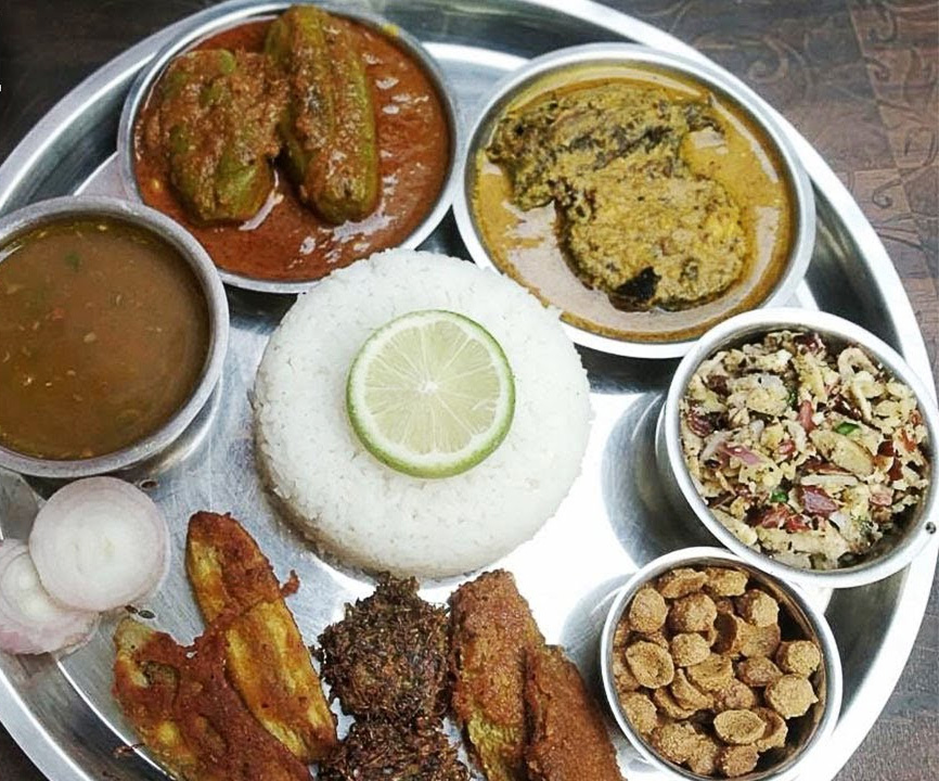 Mithila thali includes kumhrauri, raw banana and other vegetable fritters, stuffed parwal, bhoonja (dry vegetable).