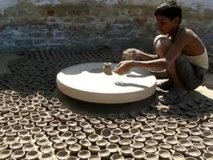 Potter making earthen lamp clay lamp or diya for diwali. Pottery craft is going down as more and more people are now shifting to electric lights and metal diyas.