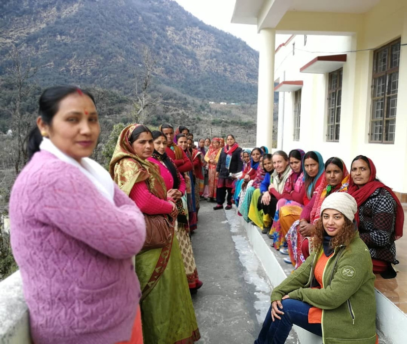 Poonam Rawat-Hahne (seated, front), founder,  Fernweh Fair Travel, with women from neighbouring villages.