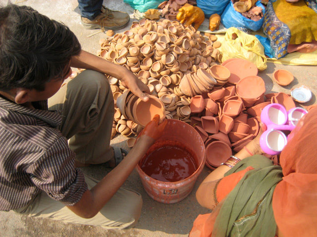 Geru, a natural earthen colour, is often used to colour and brighten the diyas.