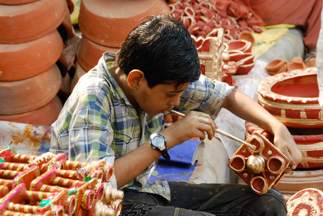Diyas are also painted with colours and decorated for Diwali.