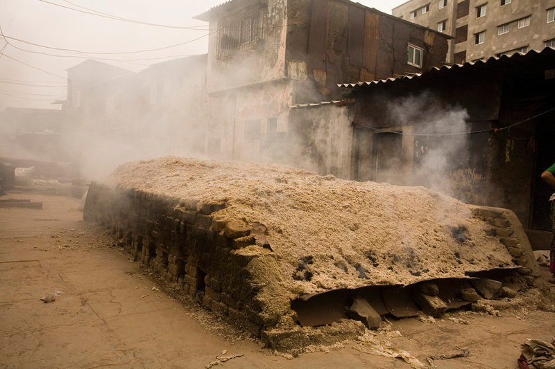 The kiln is covered with cow dung, soil etc to maintain temperature