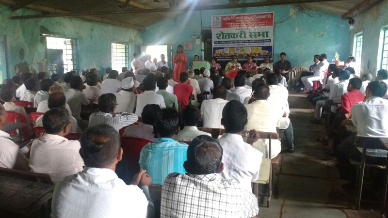 Rasika addressing farmers at a district-level meet