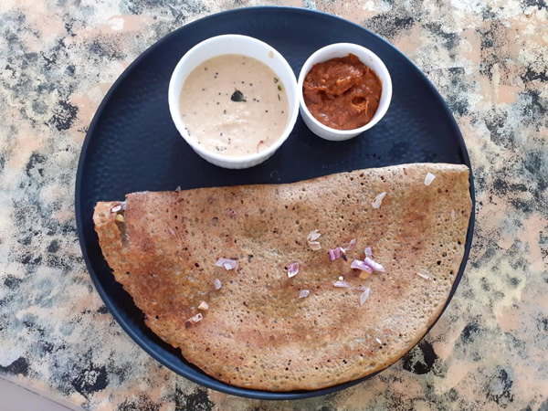 Pesarattu , a dosa made of whole green moong is an important breakfast item served with chutneys. Pic: Sumitra Kalapatapu