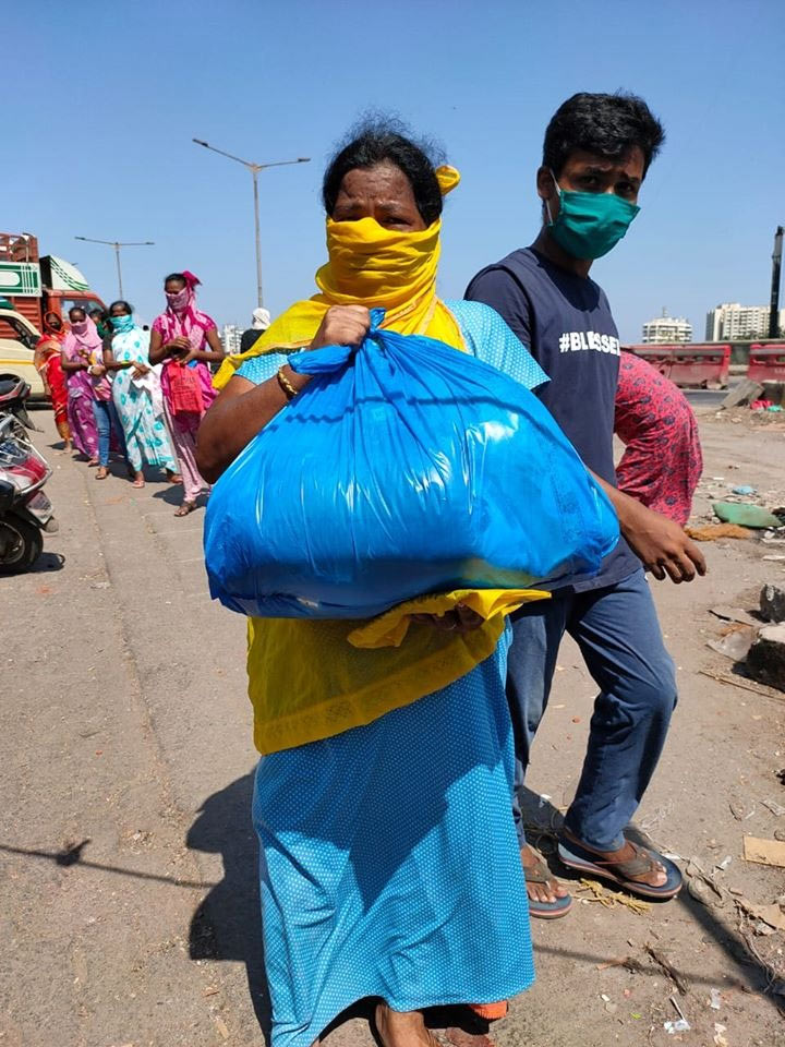 A woman in Dharavi after collecting ration from NGO Dharavi Diary. Beginning December 25, no new case has been reported from Dharavi, Asia's largest slum, which was one of the worst affected by COVID-19. Pic: Dharavi Diary