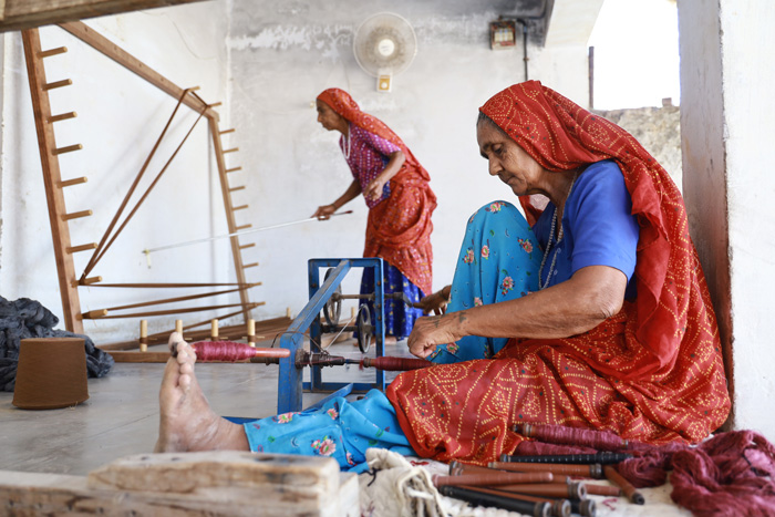 After dyeing, the yarn is dried in the sun. The yarn for the weft (bano) is filled in bobbins using the charkha.   Pic: Shamji Valji 30 stades