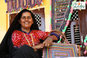 Gujarat Pabiben Rabari with her Pabi bag