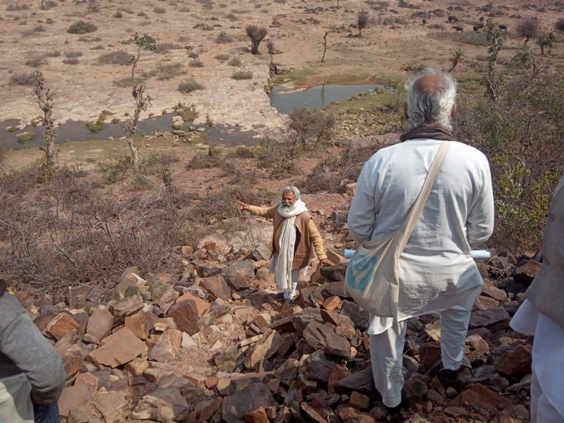 TBS Founder Rajendra Singh with his team surveying an area for water conservation. Pic: Facebook/@jalpurush