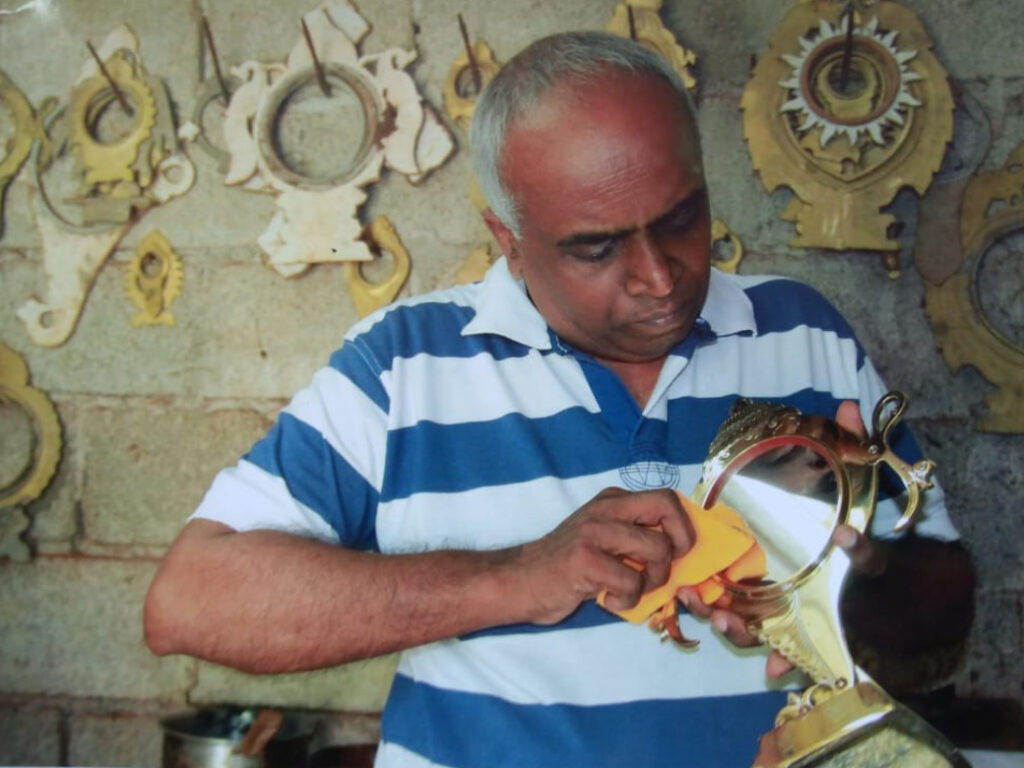 R Gopakumar giving finishing touches after fixing a metal mirror in the stand. Pic: courtesy R Gopakumar