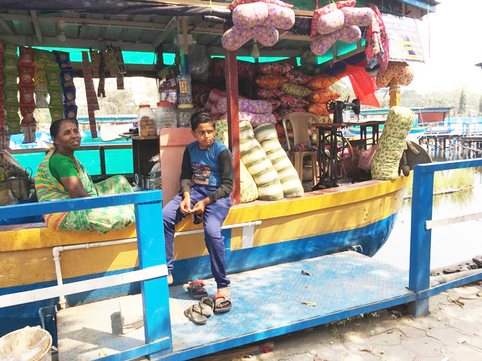 Boat shops in the floating market sell vegetables, fruits, flowers, fish, groceries and everything else in between.