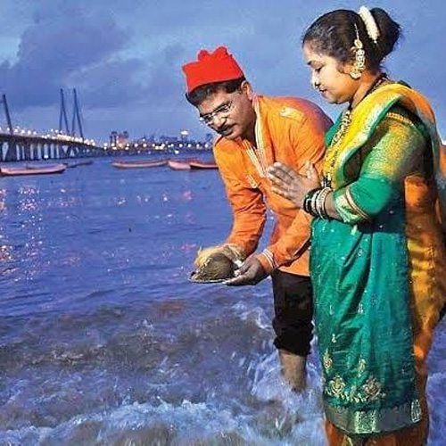 A Koli couple offering coconut to the sea on Narial Poornima. Pic: Flickr