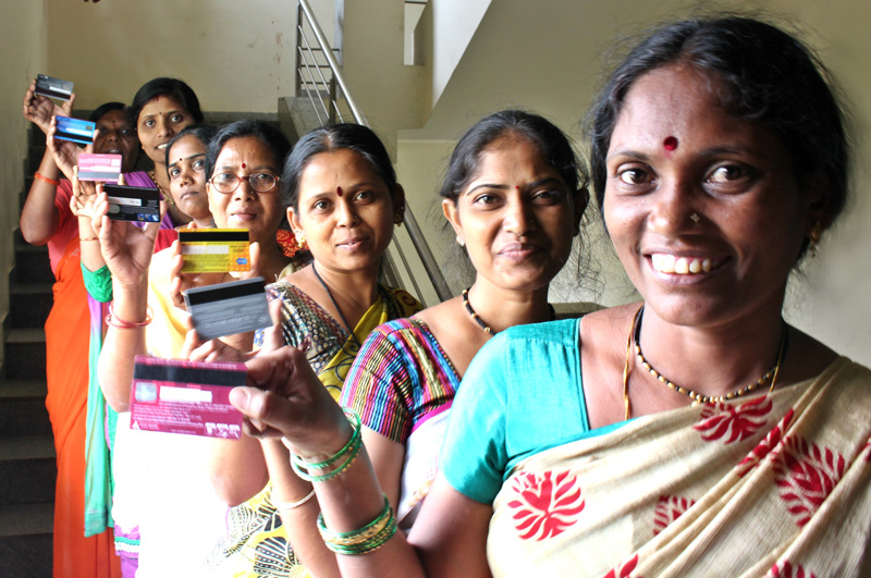 Abiras, as workers at Abira are called, displaying their ATM Cards. Pic: through Abira Creations