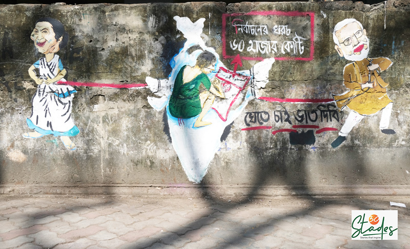 """Graffiti made by Suman Mitra with the help of street Children, who said: """"Election expense is Rs 60,000 crore….want to eat some rice. Can they provide some food?"""" Pic: Soumik Kundu 30 stades"""