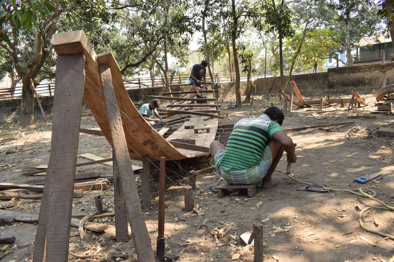 Workers preparing the backbone of boat at a unit in Balagarh