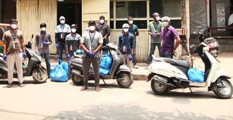 Good Quest volunteers leave for meal distribution in Bengaluru