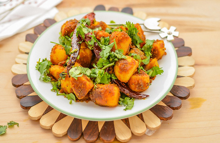 Aloo ke gutke is a popular street food and teatime snack made by slow roasting parboiled potatoes with spices. Pic: Flickr 30 stades