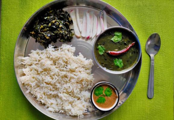 Bhatt  (black soybeans) ki chudkani is made by blending the beans with a paste of rice. Served here with rice, thechwani, mountain radish and greens. Pic: Flickr  30 stades
