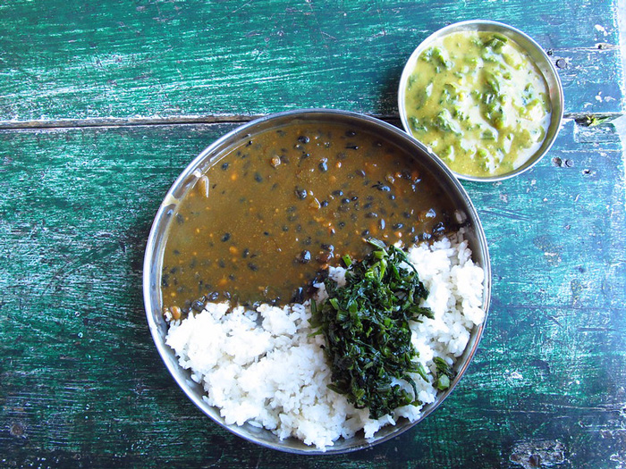 Bhatt ki dal (black soybeans), rice and greens served for lunch. Pic: Flickr 30 stades