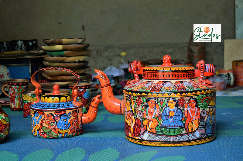 Patachitra painted kettles and glass depicting tales from Hindu mythology. Pic: Partho Burman