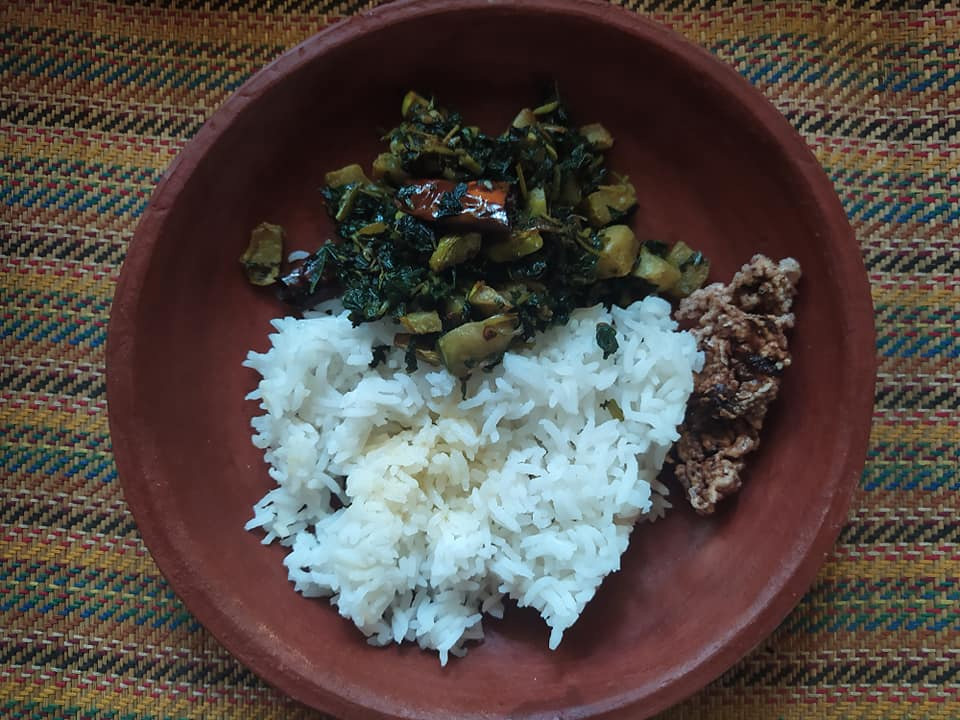 Sweet potato leaves sautéed with garlic, bottle gourd and dried red chilli, served with rice and chutney. Pic: Facebook/@ForgottenGreens 30stades