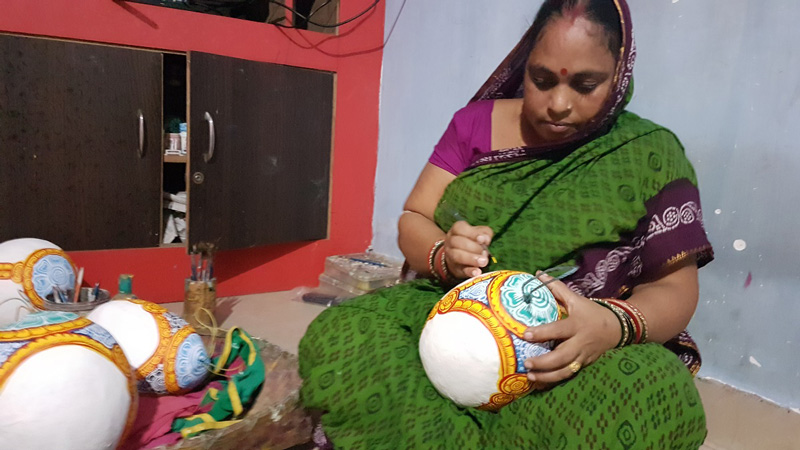Making Pattachitra on cleaned coconut shell - recycled art. Pic: Manish Kumar 30 stades