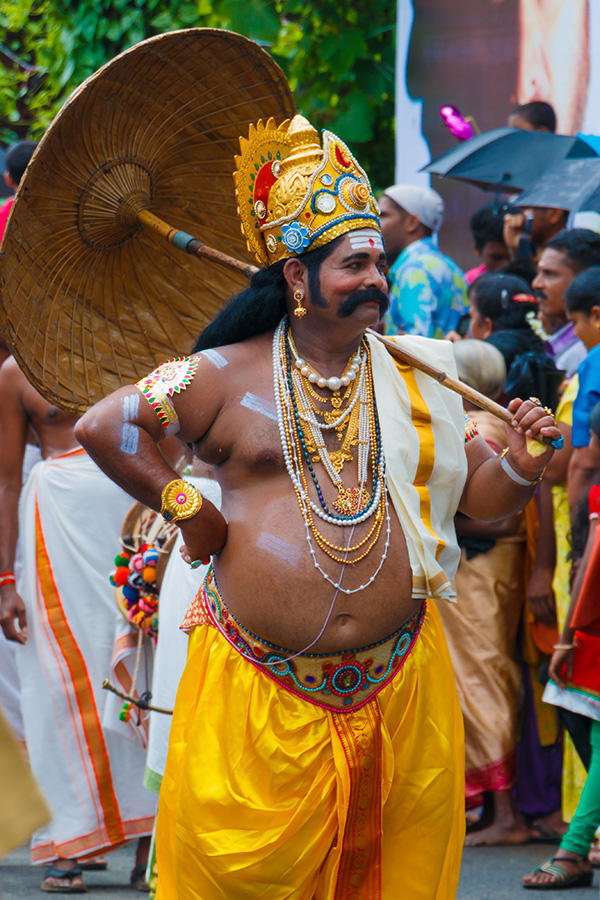 A man dressed as King Mahabali performing a street play during Onam. Dance, music and cultural activities are  held across the state during the 10-day festival. Pic: Flickr  30 stades
