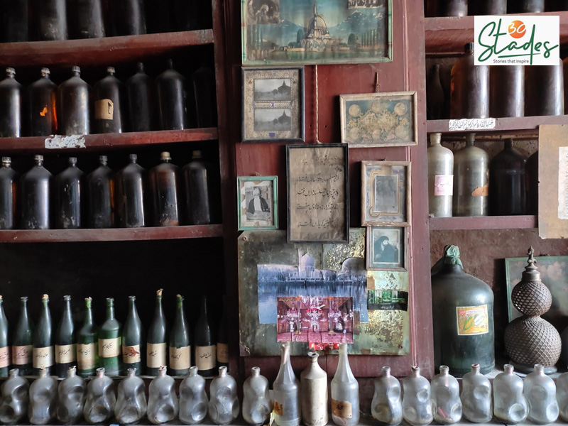 Antique jars are a reminder of the bygone era. The shop's walls also have Persian couplets and photos of saints. Pic: Parsa Mahjoob
