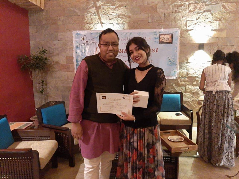 Abhijit's student Anushka Basu receives the best actress award in 2019 during Bhopal's Jane Austen Fest for playing the role of Emma Knightely. Pic: courtesy Abhijit C Chandra 30 stades