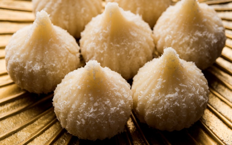 Coconut Modak: Made using desiccated coconut, condensed milk, cardamom and stuffed with jaggery and roasted fresh coconut. Pic: Flickr