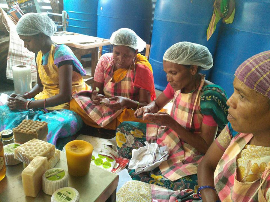 Tribal women making products from beeswax at an Aadhimalai processing centre in the Nilgiris. Pic:  AAPCL  30stades