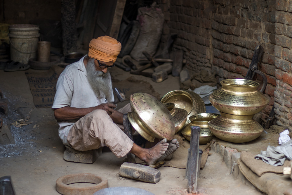 Thatheras handcraft brass, copper and bronze utensils. About 100 years back, 500 families were engaged in this craft in Jagdiala Guru. Pic: P-TAL